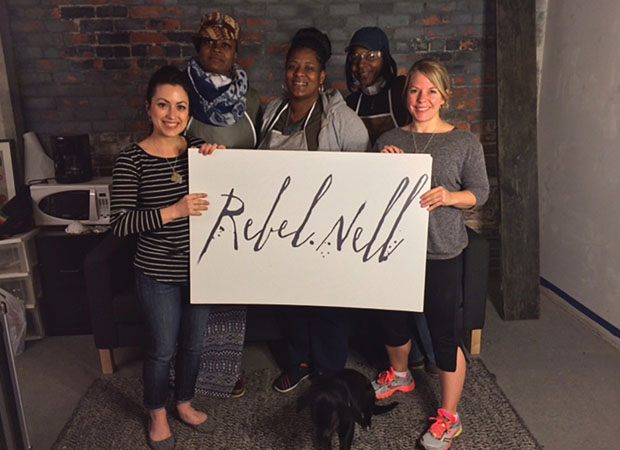 Rebel Nell Jewelry; Amy Peterson, right, with co-founder Diana Russell, left, and their Rebel Nell employees